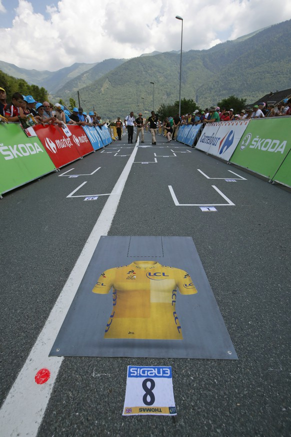 The Formula One-like start grid with overall leader Britain's Geraint Thomas's spot marked by the overall leader's yellow jersey, is seen prior to the seventeenth stage of the Tour de France cycling race over 65 kilometers (40.4 miles) with start in Bagneres-de-Luchon and finish in Saint-Lary-Soulan, Col du Portet pass, France, Wednesday July 25, 2018. The Tour de France thinks it has some solutions to liven up the action with today's shorter mountain stage with three grueling climbs, including an uphill finish, intermediate bonus sprints, and a Formula One-like grid start. (AP Photo/Christophe Ena)