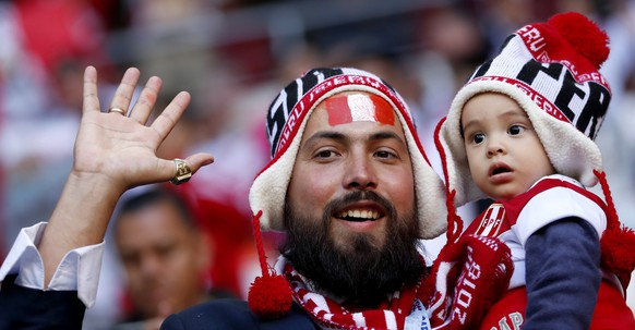 epa06813660 Supporters of Peru cheer prior to the FIFA World Cup 2018 group C preliminary round soccer match between Peru and Denmark in Saransk, Russia, 16 June 2018.  (RESTRICTIONS APPLY: Editorial Use Only, not used in association with any commercial entity - Images must not be used in any form of alert service or push service of any kind including via mobile alert services, downloads to mobile devices or MMS messaging - Images must appear as still images and must not emulate match action video footage - No alteration is made to, and no text or image is superimposed over, any published image which: (a) intentionally obscures or removes a sponsor identification image; or (b) adds or overlays the commercial identification of any third party which is not officially associated with the FIFA World Cup)  EPA/RUNGROJ YONGRIT   EDITORIAL USE ONLY
