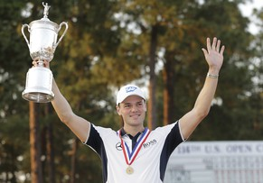Martin Kaymer, of Germany, holds up the trophy after wining the U.S. Open golf tournament in Pinehurst, N.C., Sunday, June 15, 2014.  (AP Photo/Eric Gay)