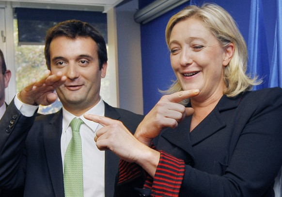FILE - In this Oct. 6, 2011 file photo, French far-right Front National party leader Marine Le Pen and her director for strategy Florian Philippot gesture during a presentation of the Front National Staff for the presidential campaign's election in Nanterre near Paris. The far-right National Front is at it again, feuding. Tensions since Marine Le Pen's loss in the May presidential race are going public with the firing of a regional leader and friend of Le Pen's top lieutenant who some claim is no longer loyal. (AP Photo/Jacques Brinon, File)