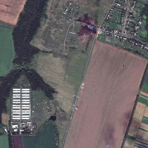 A satellite image shows the crash site of Malaysia Airlines flight MH17 in Ukraine, in this July 20, 2014 DigitalGlobe handout photo. World leaders demanded an international investigation into the shooting down of Malaysia Airlines Flight MH17 with 298 people on board over eastern Ukraine in a tragedy that could mark a pivotal moment in the worst crisis between Russia and the West since the Cold War.   REUTERS/DigitalGlobe/Handout via Reuters (UKRAINE - Tags: DISASTER TRANSPORT) ATTENTION EDITORS - THIS PICTURE WAS PROVIDED BY A THIRD PARTY. REUTERS IS UNABLE TO INDEPENDENTLY VERIFY THE AUTHENTICITY, CONTENT, LOCATION OR DATE OF THIS IMAGE. THIS PICTURE IS DISTRIBUTED EXACTLY AS RECEIVED BY REUTERS, AS A SERVICE TO CLIENTS. NO SALES. NO ARCHIVES. FOR EDITORIAL USE ONLY. NOT FOR SALE FOR MARKETING OR ADVERTISING CAMPAIGNS. MANDATORY CREDIT