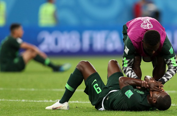 epa06842860 Odion Ighalo (down) of Nigeria reacts after the FIFA World Cup 2018 group D preliminary round soccer match between Nigeria and Argentina in St.Petersburg, Russia, 26 June 2018.  (RESTRICTIONS APPLY: Editorial Use Only, not used in association with any commercial entity - Images must not be used in any form of alert service or push service of any kind including via mobile alert services, downloads to mobile devices or MMS messaging - Images must appear as still images and must not emulate match action video footage - No alteration is made to, and no text or image is superimposed over, any published image which: (a) intentionally obscures or removes a sponsor identification image; or (b) adds or overlays the commercial identification of any third party which is not officially associated with the FIFA World Cup)  EPA/TOLGA BOZOGLU   EDITORIAL USE ONLY