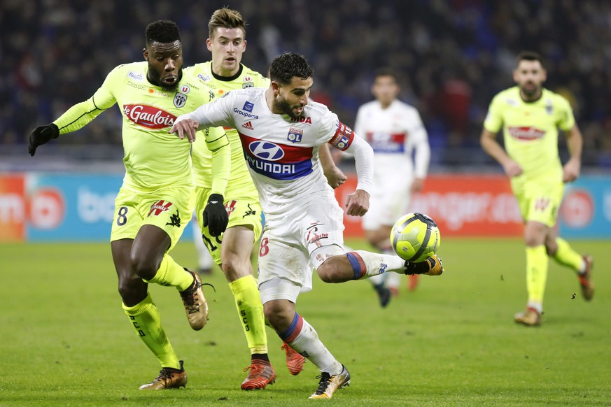 Lyon's Nabil Fekir, right, controls the ball as he challenges with Angers' Ismael Traore, left, during their French League One soccer match in Decines, near Lyon, central France, Sunday, Jan. 14, 2018. (AP Photo/Laurent Cipriani)