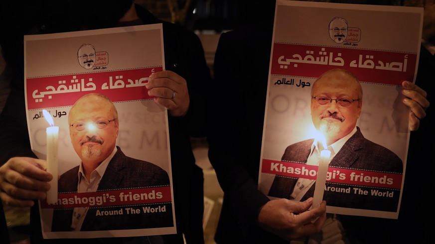 epa07119367 Protestors hold candles and pictures of Jamal Khashoggi during the demonstration in front of Saudi Arabian consulate in Istanbul, Turkey, 25 October 2018. Turkish President Erdogan addressed the parliament on the case of Saudi journalist Jamaal Khashoggi on 23 October 2018, media reported that he said that Turkish investigators have strong evidence that Khashoggi's death was planned, and demanded that the whereabouts of the dead journalist's body be revealed and the suspects face trial in Turkey. Saudi Arabian official media on 19 October reported that journalists Jamal Khashoggi died as a result of a physical altercation inside the kingdom's consulate in Istanbul, where he was last seen entering on 02 October for routine paperwork. On 24 October, Mohammed bin Salman spoke of the killing of Khashoggi for the first time, describing it as 'a heinous crime that cannot be justified', and that Saudi Arabia and Turkey will work together to punish all culprits.  EPA/ERDEM SAHIN