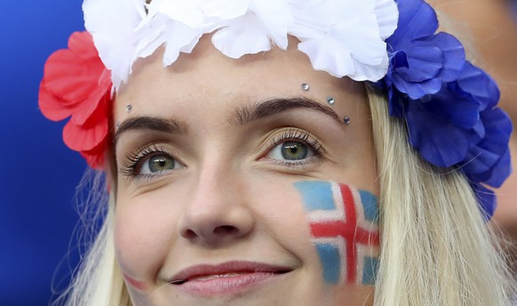 An Iceland's fan smiles prior to the Euro 2016 quarterfinal soccer match between France and Iceland, at the Stade de France in Saint-Denis, north of Paris, France, Sunday, July 3, 2016. (AP Photo/Thibault Camus)