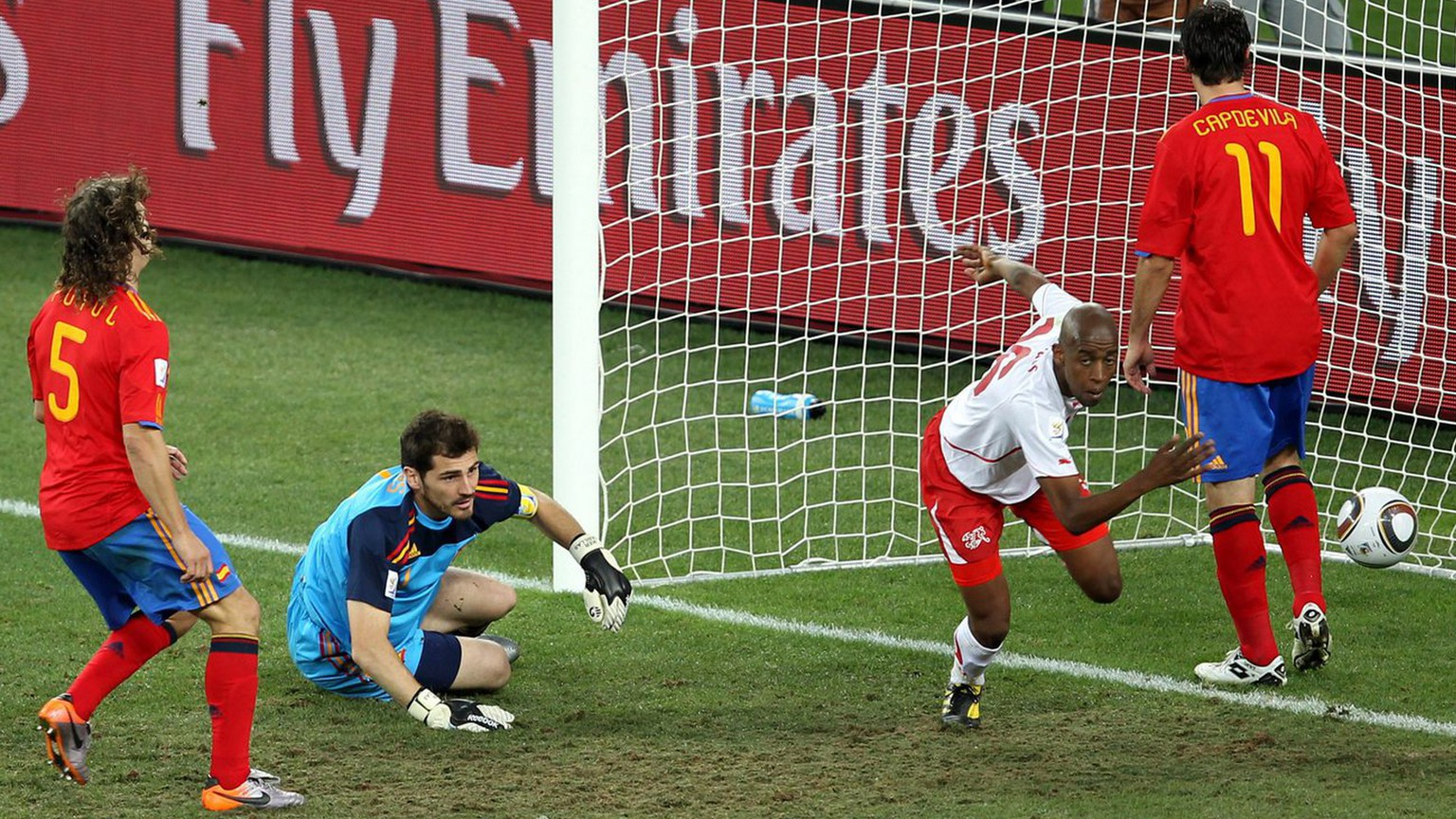 epa02205289 Swiss Gelson Fernandes (2nd R) celebates in front of Spain's goalkeeper Iker Casillas and defenders Gerard Pique (L), Carles Puyol (2nd L) and Joan Capdevila (R) after scoring the 1-0 lead uring the FIFA World Cup 2010 group H preliminary round match between Spain and Switzerland at the Durban stadium in Durban, South Africa, 16 June 2010.  EPA/ALI HAIDER Please refer to www.epa.eu/downloads/FIFA-WorldCup2010-Terms-and-Conditions.pdf