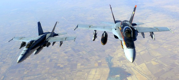 """This October 4, 2014 US Navy handout image shows two US Navy F-18E Super Hornets supporting operations against IS, after being refueled by a KC-135 Statotanker over Iraq after conducting an airstrike.  The US military unleashed a wave of air strikes against Islamic State jihadists in Syria and Iraq this weekend, destroying tanks, armored vehicles and mortar teams, a statement said October 5. AFP PHOTO / HANDOUT / US AIR FORCE / Staff Sgt. Shawn Nickel    RELEASED         == RESTRICTED TO EDITORIAL USE / MANDATORY CREDIT: """"AFP PHOTO / HANDOUT / US Air Force / Staff Sgt. Shawn Nickel  """"/ NO MARKETING / NO ADVERTISING CAMPAIGNS / NO A LA CARTE SALES / DISTRIBUTED AS A SERVICE TO CLIENTS =="""