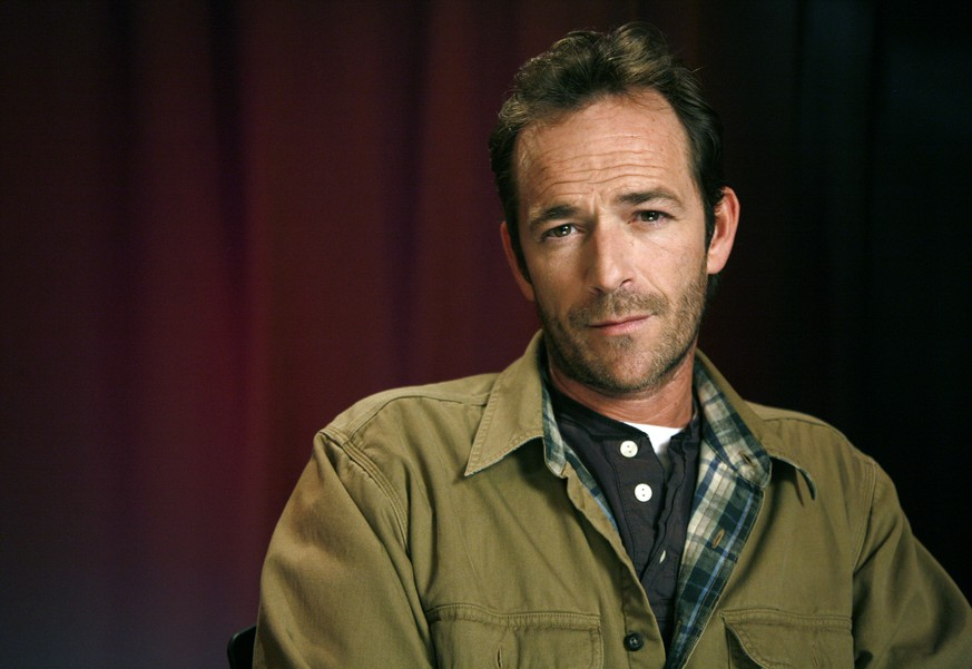 FILE - In this Jan. 26, 2011 file photo, actor Luke Perry poses for a portrait in New York. Perry, who gained instant heartthrob status as wealthy rebel Dylan McKay on