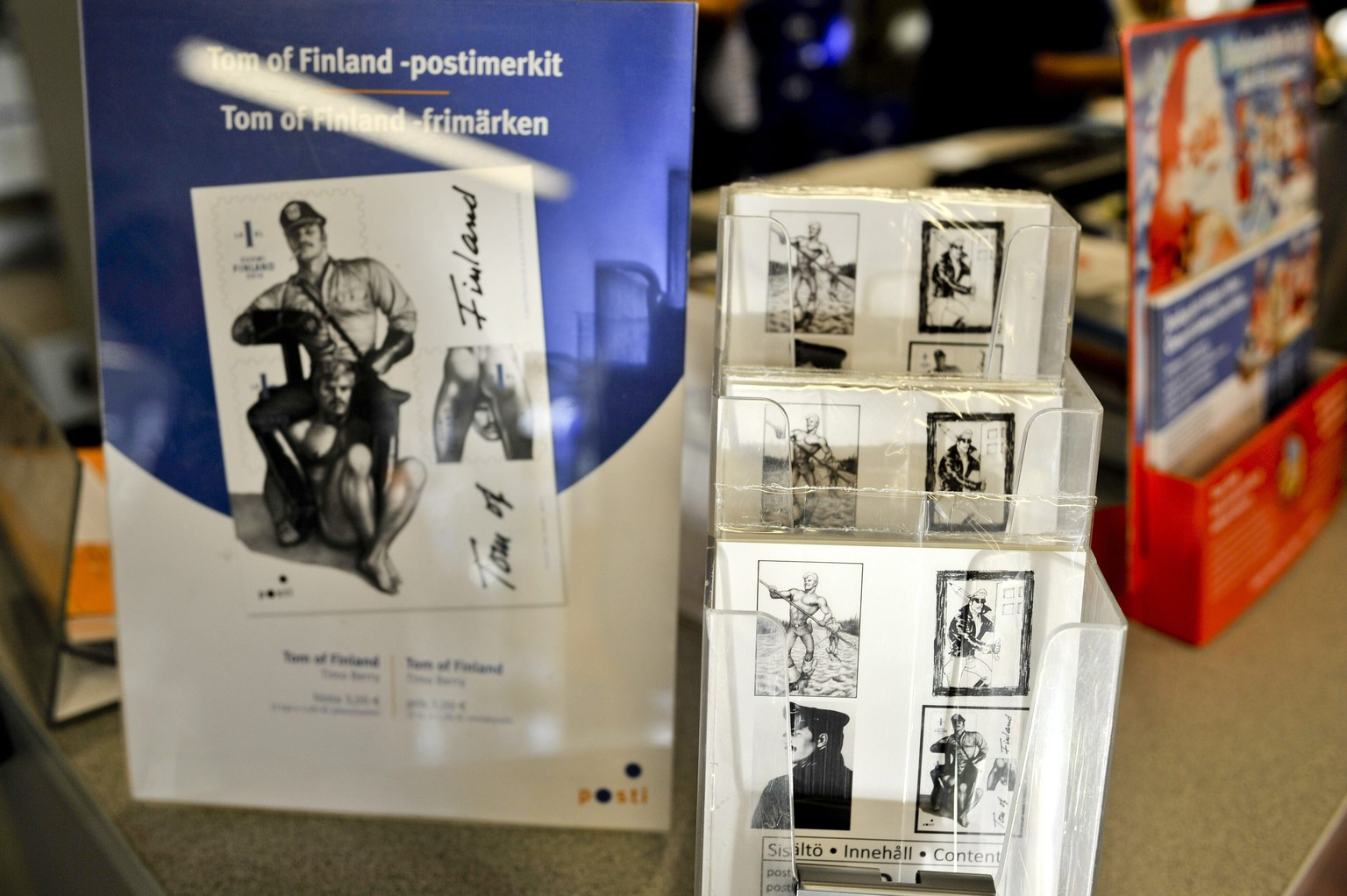 A set of homoerotic Finnish stamps featuring images by gay icon and artist Tom of Finland are on sale at a post office in Helsinki on September 8, 2014. Tom of Finland, whose real name was Touko Laaksonen (1920-1991), is venerated internationally in gay circles for his explicit sexual drawings, which he created at a time when homosexuality was still taboo in the West.   AFP PHOTO / LEHTIKUVA / JARI LAM   *** FINLAND OUT ***     RESTRICTED TO EDITORIAL USE - MANDATORY MENTION OF THE ARTIST UPON PUBLICATION, TO ILLUSTRATE THE EVENT AS SPECIFIED IN THE CAPTION