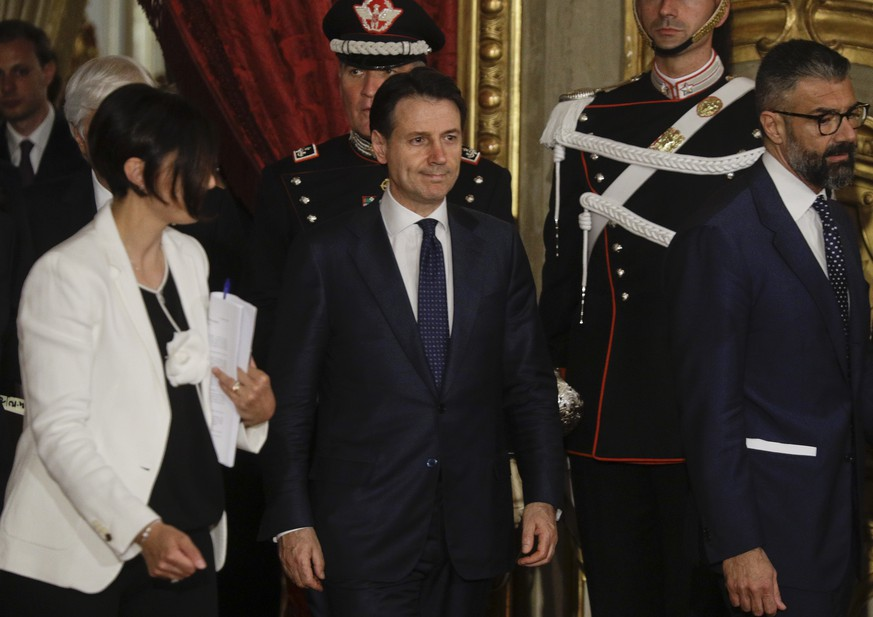 Italy's Premier Giuseppe Conte arrives for the swearing-in ceremony of Italy's new government at Rome's Quirinale Presidential Palace, Friday, June 1, 2018. (AP Photo/Gregorio Borgia)