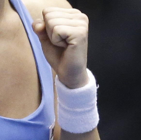 Italy's Camila Giorgi pumps her fist as she celebrates after defeating United States' Madison Keys during a Fed Cup world group tennis match Saturday, Feb. 8, 2014, in Cleveland. (AP Photo/Tony Dejak)