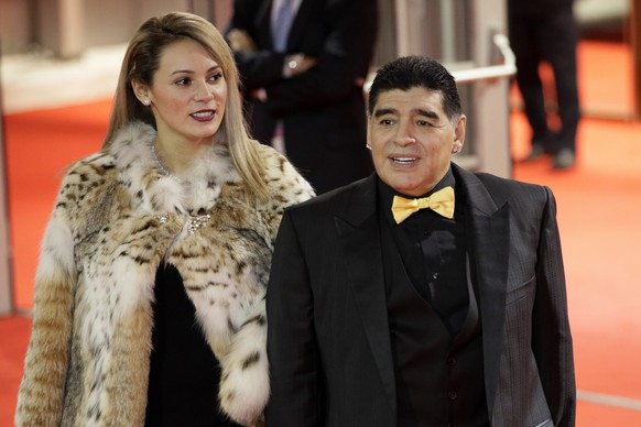 Argentinian soccer legend Diego Maradona and his girlfriend Rocio Oliva arrive for the 2018 soccer World Cup draw in the Kremlin in Moscow, Friday, Dec. 1, 2017. (AP Photo/Dmitri Lovetsky)
