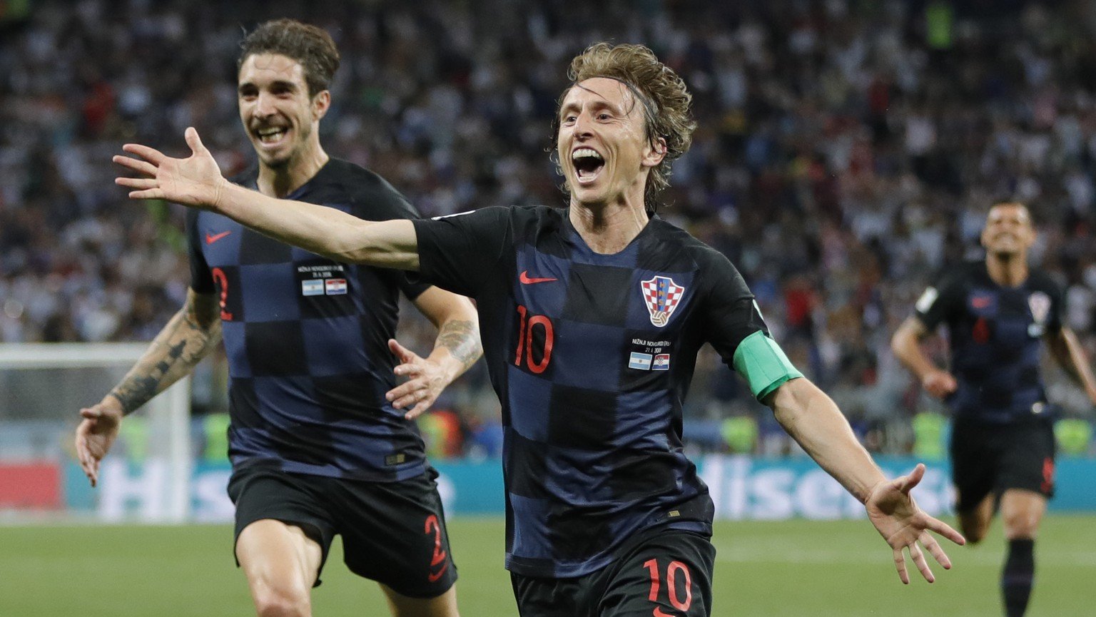 Croatia's Luka Modric, right, celebrates with teammates after scoring his side's second goal during the group D match between Argentina and Croatia at the 2018 soccer World Cup in Nizhny Novgorod Stadium in Nizhny Novgorod, Russia, Thursday, June 21, 2018. (AP Photo/Ricardo Mazalan)