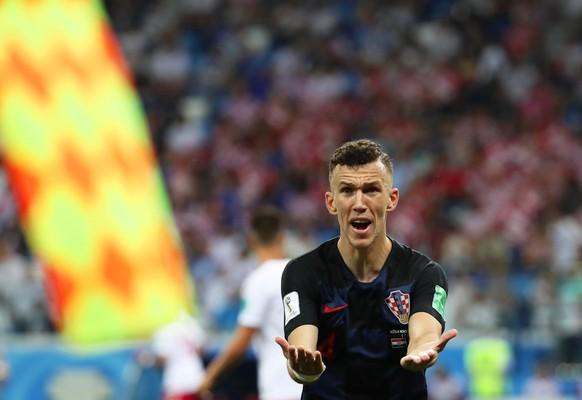 epa06856404 Ivan Perisic of Croatia reacts during the FIFA World Cup 2018 round of 16 soccer match between Croatia and Denmark in Nizhny Novgorod, Russia, 01 July 2018.  (RESTRICTIONS APPLY: Editorial Use Only, not used in association with any commercial entity - Images must not be used in any form of alert service or push service of any kind including via mobile alert services, downloads to mobile devices or MMS messaging - Images must appear as still images and must not emulate match action video footage - No alteration is made to, and no text or image is superimposed over, any published image which: (a) intentionally obscures or removes a sponsor identification image; or (b) adds or overlays the commercial identification of any third party which is not officially associated with the FIFA World Cup)  EPA/VASSIL DONEV   EDITORIAL USE ONLY