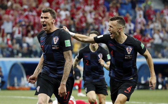 epa06856148 Mario Mandzukic of Croatia reacts with Ivan Perisic of Croatia (R) after scoring the 1-1 the FIFA World Cup 2018 round of 16 soccer match between Croatia and Denmark in Nizhny Novgorod, Russia, 01 July 2018.  (RESTRICTIONS APPLY: Editorial Use Only, not used in association with any commercial entity - Images must not be used in any form of alert service or push service of any kind including via mobile alert services, downloads to mobile devices or MMS messaging - Images must appear as still images and must not emulate match action video footage - No alteration is made to, and no text or image is superimposed over, any published image which: (a) intentionally obscures or removes a sponsor identification image; or (b) adds or overlays the commercial identification of any third party which is not officially associated with the FIFA World Cup)  EPA/FRANCK ROBICHON   EDITORIAL USE ONLY
