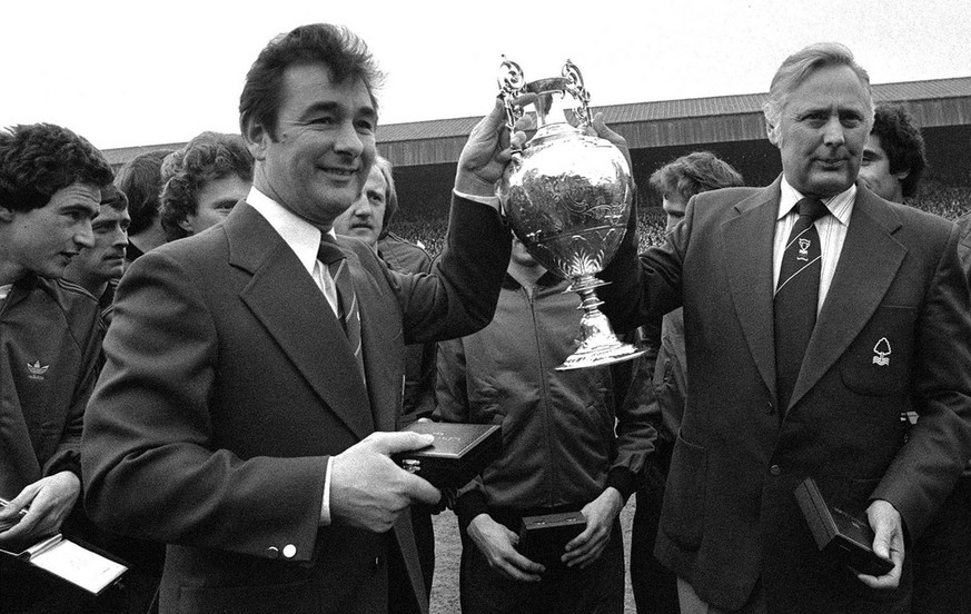 April 30, 1978 photo of Nottingham Forest soccer team manager Brian Clough, left, and assistant manager Peter Taylor, holding the English League Championship trophy after it had been presented to Forest at the City Ground in Nottingham, England. Brian Clough, who led Nottingham Forest to back- to-back European Cup titles in 1979 and 1980 but became known as the
