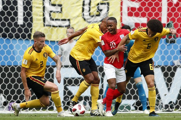 Belgium's Toby Alderweireld, from left, Belgium's Vincent Kompany, England's Raheem Sterling and Belgium's Axel Witsel challenge for the ball during the third place match between England and Belgium at the 2018 soccer World Cup in the St. Petersburg Stadium in St. Petersburg, Russia, Saturday, July 14, 2018. (AP Photo/Natacha Pisarenko)