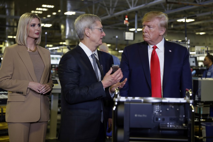 President Donald Trump tours an Apple manufacturing plant, Wednesday, Nov. 20, 2019, in Austin with Apple CEO Tim Cook, left, and Ivanka Trump, the daughter and adviser of President Donald Trump. (AP Photo/ Evan Vucci) Donald Trump