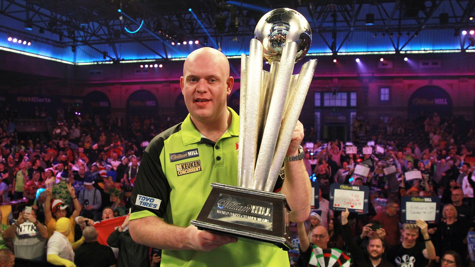 epa07257608 Dutch Michael van Gerwen celebrates with the trophy after winning the PDC World Championship final match against British Michael Smith at the Alexander Palace in North London, Britain, 01 January 2019.  EPA/SEAN DEMPSEY
