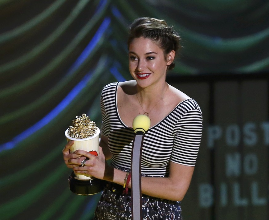 Actress Shailene Woodley accepts the award for Best Female Performance for