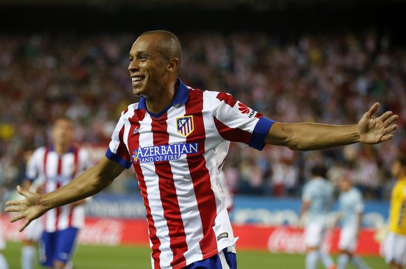 Atletico Madrid's Miranda celebrates his goal against Eibar during their Spanish first division soccer match at Vicente Calderon stadium in Madrid August 30, 2014. REUTERS/Andrea Comas (SPAIN - Tags: SPORT SOCCER)