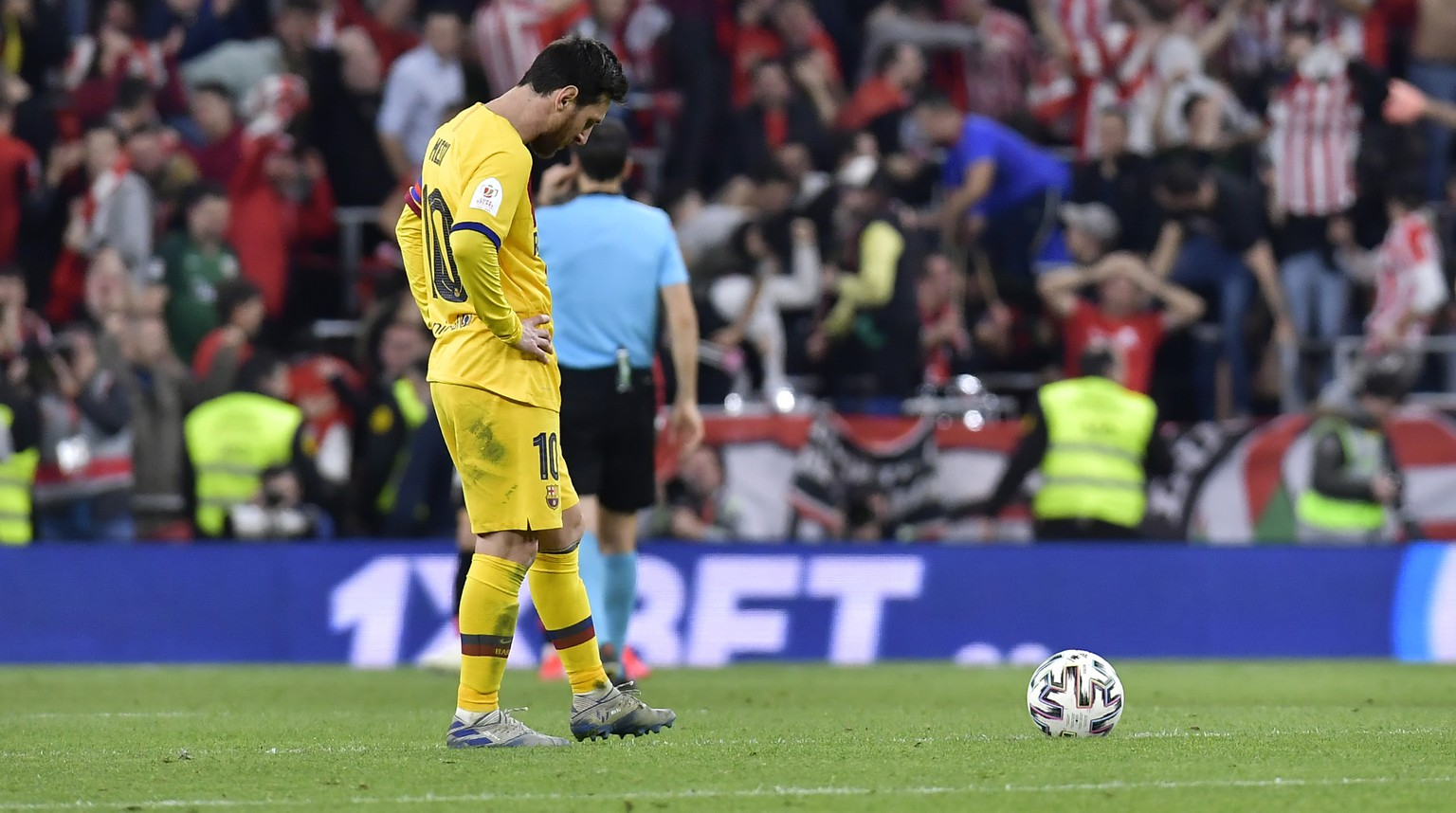 Barcelona's Lionel Messi stands in dejection at the end of the Spanish Copa del Rey, quarter final, soccer match between Athletic Bilbao and Barcelona at San Mames stadium in Bilbao, Spain, Thursday, Feb. 6, 2020. Athletic Bilbao won 1-0. (AP Photo/Alvaro Barrientos)
