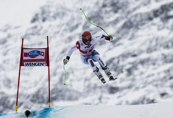 Patrick Kueng of Switzerland in action at the Silberhorn jump during a men's downhill training at the FIS Ski World Cup at the Lauberhorn in Wengen, Switzerland, Thursday, January 16, 2014. (KEYSTONE/Peter Schneider)