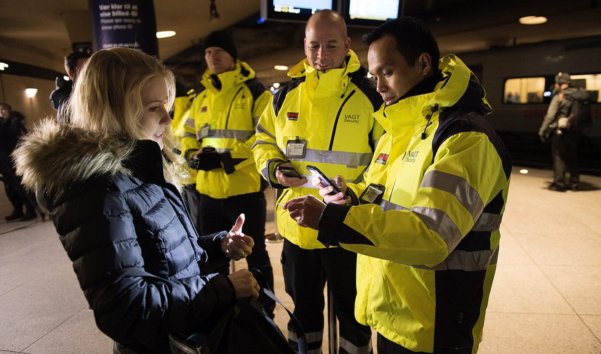 epa05087464 Security staff check IDs at Kastrups train station outside Copenhagen, Denmark, 04 January 2015. Identity checks went into effect for  travellers from Denmark to Sweden as part of measures to reduce the flow of migrants into Sweden. Passengers boarding trains, ferries or buses bound for Sweden have to show a passport or other form of valid ID card to be allowed onboard under the new rules. Transport companies are responsible for conducting the checks. Danish train operator DSB said it has set up 34 check points at the Kastrup train station that serves Copenhagen Airport, and is the last train stop before the Swedish border.  EPA/NILS MEILVANG DENMARK OUT