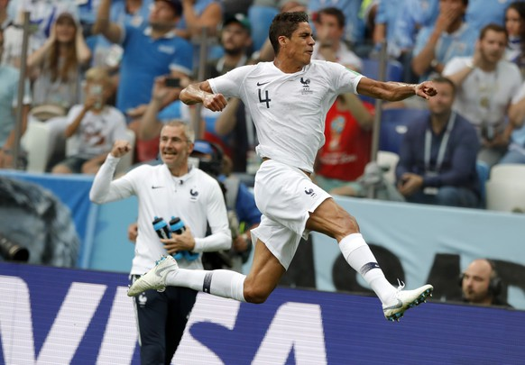 France's Raphael Varane, right, celebrates after scoring his side's opening goal during the quarterfinal match between Uruguay and France at the 2018 soccer World Cup in the Nizhny Novgorod Stadium, in Nizhny Novgorod, Russia, Friday, July 6, 2018. (AP Photo/Ricardo Mazalan)