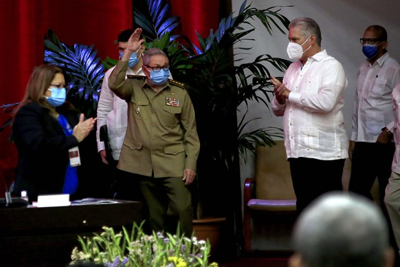 Raul Castro, first secretary of the Communist Party and former president, waves to members at the VIII Congress of the Communist Party of Cuba's opening session, as Cuban President Miguel Diaz-Canel, right, applauds at the Convention Palace, in Havana, Cuba, Friday, April 16, 2021. (Ariel Ley Royero/ACN via AP) Raul Castro,Miguel Diaz-Canel