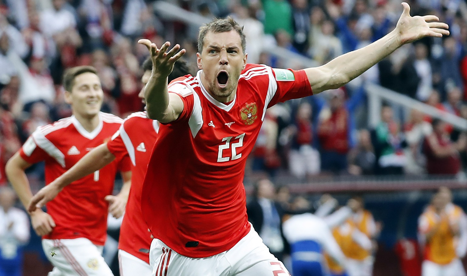 epa06807706 Artem Dzyuba of Russia celebrates after scoring the 3-0 goal during the FIFA World Cup 2018 group A preliminary round soccer match between Russia and Saudi Arabia in Moscow, Russia, 14 June 2018.
