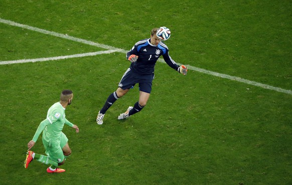 Germany's goalkeeper Manuel Neuer heads the ball during the World Cup round of 16 soccer match between Germany and Algeria at the Estadio Beira-Rio in Porto Alegre, Brazil, Monday, June 30, 2014. (AP Photo/Fabrizio Bensch, pool)