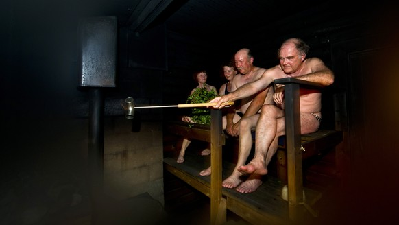 In this July 18, 2012 photo, people sit in a sauna at a Finnish summer cottage, in Leppavirta, central Finland. Frequent sauna baths may help you live longer, a study of Finnish men suggests. (AP Photo/Lehtikuva, Roni Rekomaa) FINLAND OUT
