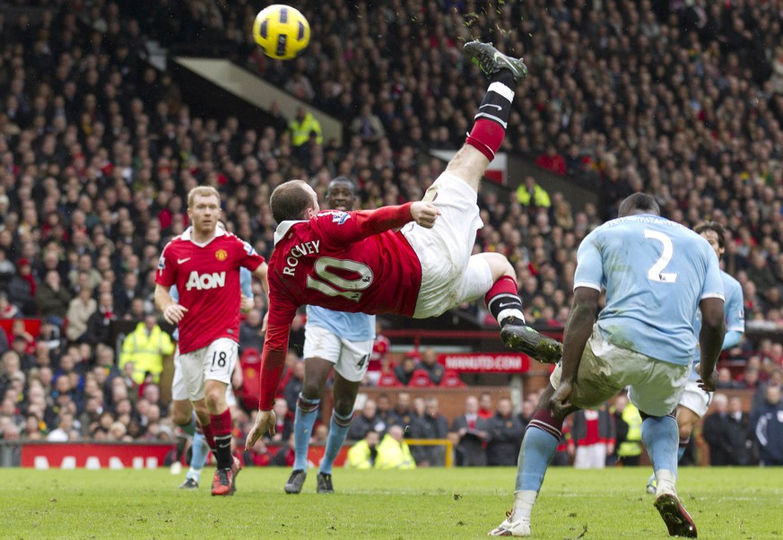 FILE - In this Feb. 12, 2011, file photo, Manchester United's Wayne Rooney, center, scores the game-winning goal with an overhead kick against Manchester City during their English Premier League soccer match at Old Trafford Stadium, Manchester, England. Rooney's fantastic finish is featured on the 10-goal shortlist published by FIFA on Friday, Nov. 18, 2011, competing to be chosen as the best score in 2011. (AP Photo/Jon Super, File)