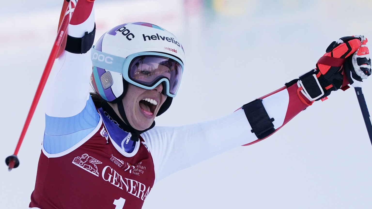 Switzerland's Michelle Gisin reacts after completing an alpine ski, women's World Cup giant slalom, in Kranjska Gora, Slovenia, Saturday, Jan. 16, 2021. (AP Photo/Giovanni Auletta)