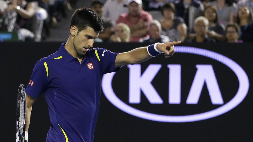 Novak Djokovic of Serbia gestures for his towel during his quarterfinal match against Kei Nishikori of Japan at the Australian Open tennis championships in Melbourne, Australia, Tuesday, Jan. 26, 2016.(AP Photo/Aaron Favila)