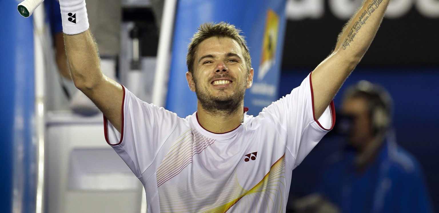 epa04038038 Stanislas Wawrinka of Switzerland celebrates after winning his semifinal match against Tomas Berdych of the Czech Republic for the Australian Open Grand Slam tennis tournament in Melbourne, Australia, 23 January 2014.  EPA/NARENDRA SHRESTHA