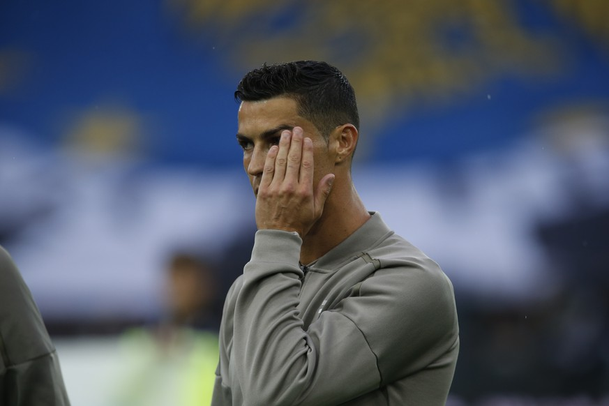 Juventus forward Cristiano Ronaldo warms up prior to the Serie A soccer match between Udinese and Juventus, at the Dacia Arena stadium in Udine, Italy, Saturday, Oct.6, 2018. Cristiano Ronaldo is back in Juventus' starting lineup, a week after a Nevada woman filed a civil lawsuit accusing him of rape nine years ago. (AP Photo/Antonio Calanni)