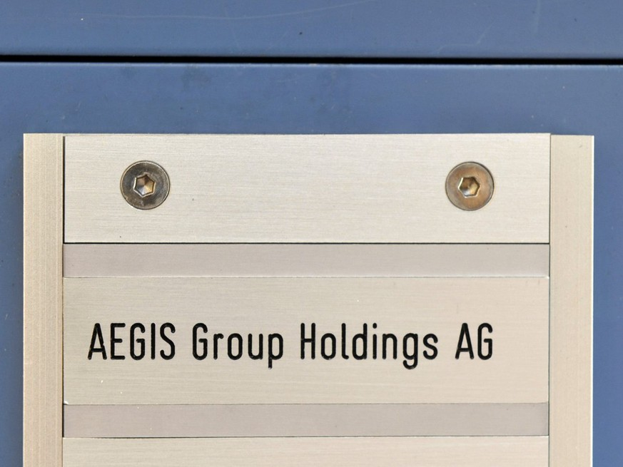 SIgn of the Aegis Group Holdings AG in Basel, Switzerland, on Friday 20, 2010. The British private army Aegis Defence Services has transferred its headquarters to Basel at the end of July. The group for Switzerland without army, GSoA, asks for a general ban of private armies in Switzerland. (KEYSTONE/Georgios Kefalas)