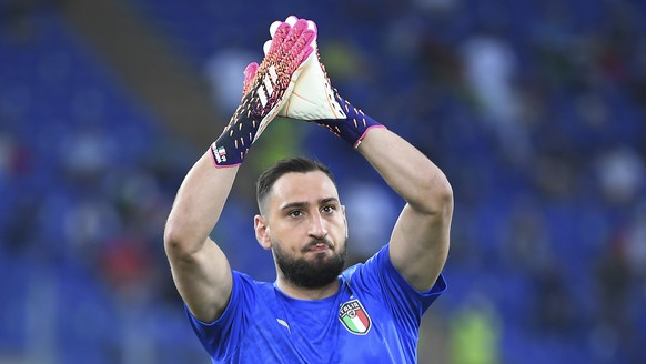 Italy's goalkeeper Gianluigi Donnarumma waves his fans prior to the start of the Euro 2020 soccer championship group A match between Italy and Switzerland at Olympic stadium in Rome, Wednesday, June 16, 2021. (Ettore Ferrari, Pool via AP)