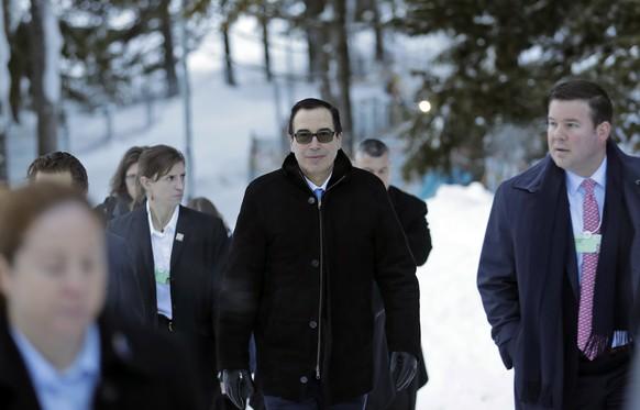 Steven Mnuchin, United States Secretary of the Treasury, walks through the snow during the annual meeting of the World Economic Forum in Davos, Switzerland, Wednesday, Jan. 24, 2018. (AP Photo/Markus Schreiber)