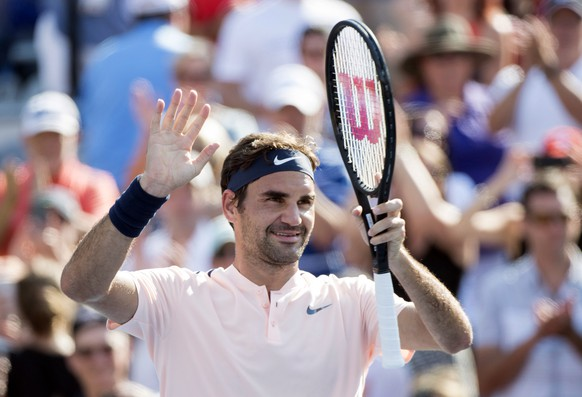 Roger Federer, of Switzerland, celebrates after defeating Robin Haase, of the Netherlands, in Rogers Cup tennis action, in Montreal on Saturday, Aug. 12, 2017. (Paul Chiasson/The Canadian Press via AP)