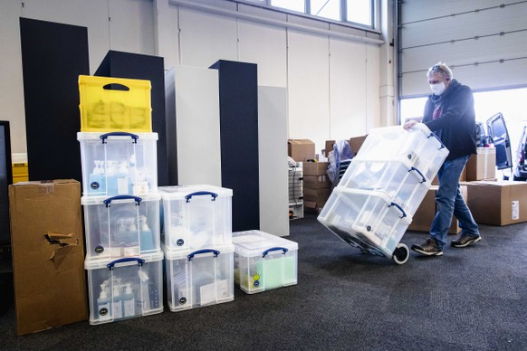 epa08911003 An employee brings equipment to administer the vaccine, during the set up of a vaccination center at the Expo Houten, The Netherlands, 30 December 2020. The location is one of the three locations where on 08 January 2021 the vaccination against Covid-19 will start in The Netherlands.  EPA/SEM VAN DER WAL