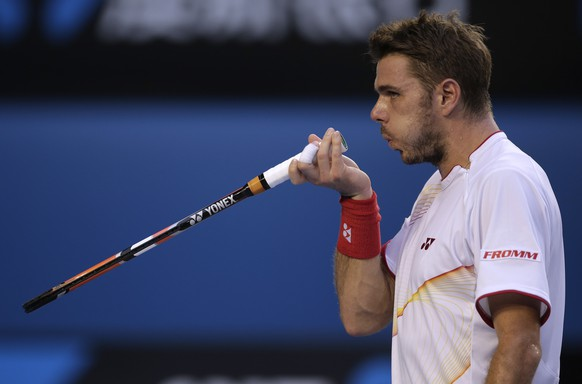Stanislas Wawrinka of Switzerland reacts between points as he plays Tomas Berdych of the Czech Republic during their semifinal at the Australian Open tennis championship in Melbourne, Australia, Thursday, Jan. 23, 2014.(AP Photo/Rick Rycroft)