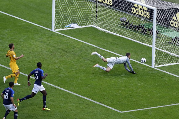 Australia goalkeeper Mathew Ryan fails to save the ball as France's Paul Pogba, second right, scores his side's second goal during the group C match between France and Australia at the 2018 soccer World Cup in the Kazan Arena in Kazan, Russia, Saturday, June 16, 2018. (AP Photo/Hassan Ammar)