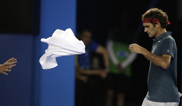 Roger Federer of Switzerland throws a towel between points as he plays Rafael Nadal of Spain during their semifinal at the Australian Open tennis championship in Melbourne, Australia, Friday, Jan. 24, 2014.(AP Photo/Rick Rycroft)
