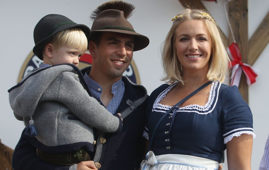 MUNICH, GERMANY - SEPTEMBER 30:  Philipp Lahm of FC Bayern Muenchen, his wife Claudia and son Julian attend the Oktoberfest beer festival 2015 at Theresienwiese on September 30, 2015 in Munich, Germany.  (Photo by Alexandra Beier/Bongarts/Getty Images)