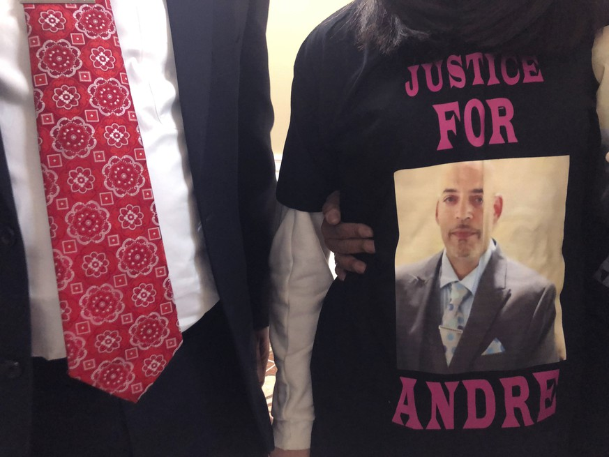 FILE - Andre Hill, fatally shot by Columbus police on Dec. 22, is memorialized on a shirt worn by his daughter, Karissa Hill, on Thursday, Dec. 31, 2020, in Columbus, Ohio. A white Ohio police officer was indicted Wednesday, Feb. 3, 2021 on murder charges in the December shooting death of 47-year-old Andre Hill. Columbus Police Officer Adam Coy was indicted by a Franklin County grand jury on Wednesday following an investigation by the Ohio Attorney General