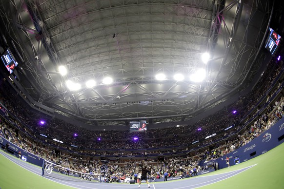Roger Federer,  of Switzerland, warms up for a match against Frances Tiafoe, of the United States, under the closed roof at Arthur Ashe Stadium at the U.S. Open tennis tournament, Tuesday, Aug. 29, 2017, in New York. (AP Photo/Julio Cortez)