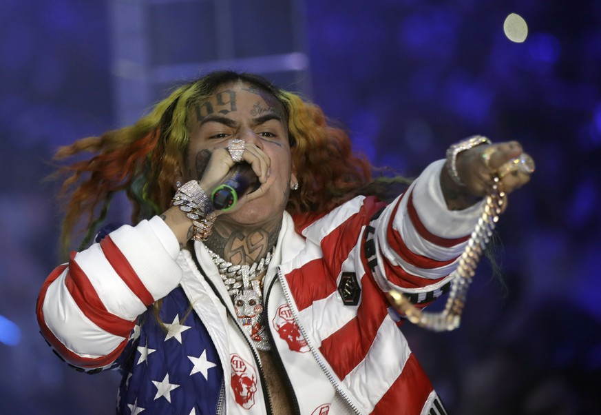 FILE- In this Sept. 21, 2018, file photo rapper Daniel Hernandez, known as Tekashi 6ix9ine, performs during the Philipp Plein women's 2019 Spring-Summer collection, unveiled during the Fashion Week in Milan, Italy. Tekashi 6ix9ine was sentenced to 2 years in prison Wednesday, Dec. 18, 2019 for his entanglement with a violent street gang that fueled his rise to fame, but was spared a much harsher possible sentence because of his extraordinary decision to become a star witness for prosecutors.  (AP Photo/Luca Bruno, File)